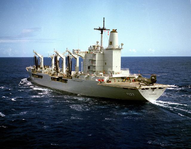 A port quarter view of the fleet oiler USS CIMARRON (AO 177) underway