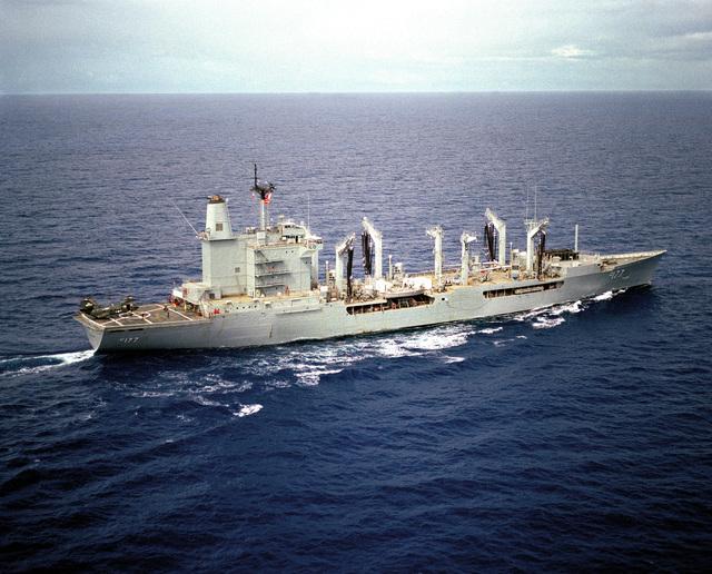 A starboard view of the fleet oiler USS CIMARRON (AO 177) underway