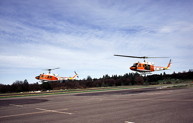 A left front view of two Search and Rescue (SAR) UH-1N Iroquois helicopters from Naval Air Station Fallon, Nevada, taking off during training operations