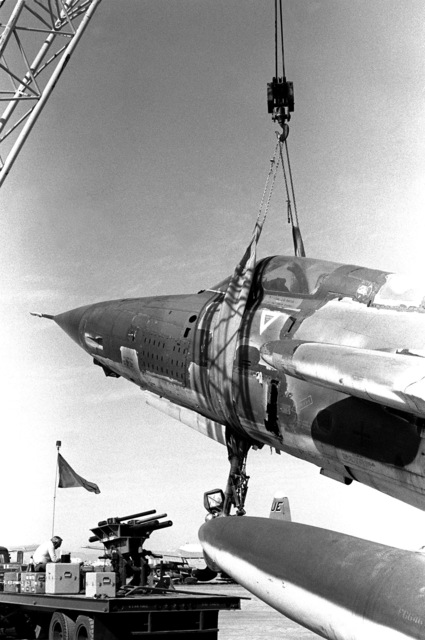 Members of the 402nd Combat Logistic Support Squadron prepare an F-105 Thunderchief aircraft for restoration at the Military Aircraft Storage and Disposition Center. The 402nd is rebuilding the F-105 under battlefield conditions during exercise Proud Saber