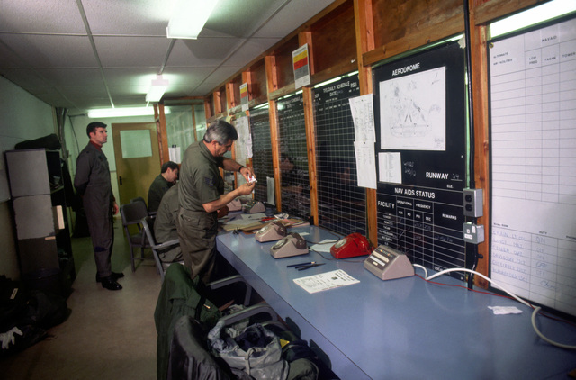 Air Force personnel work in the command post at Bldg. 1201 during Exercise CHECKERED FLAG (CORONET CASTLE)