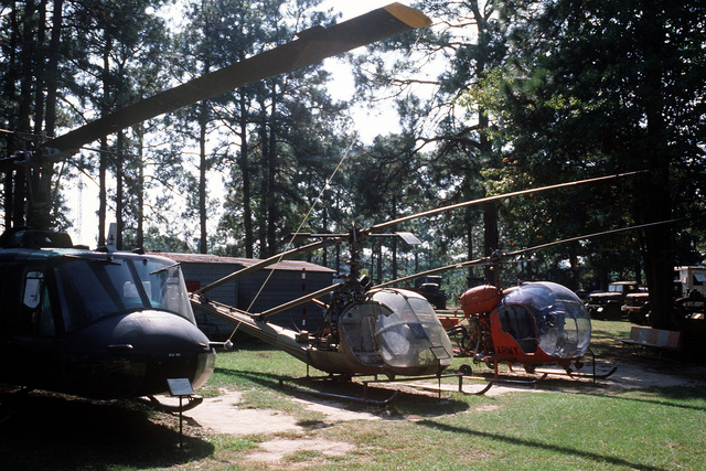 Helicopters on display at the Fort Polk Military Museum outdoor park include the UH-1B Iroquois (l), the OH-23B Raven, and the TH-13T Sioux (r)