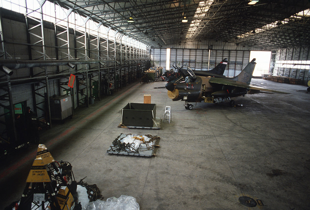 Two A-7D Corsair II aircraft inside the maintenance hangar during Exercise CHECKERED FLAG (CORONET CASTLE)