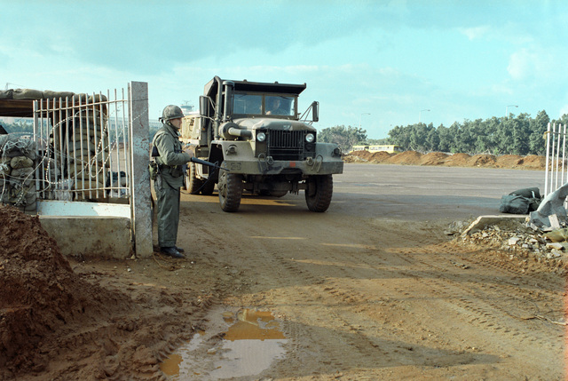 A large cargo truck departs from a US Marine Corps encampment. The Marines have been deployed in Lebanon as part of a multi-national peacekeeping force following confrontation between Israeli forces and the Palestine Liberation Organization