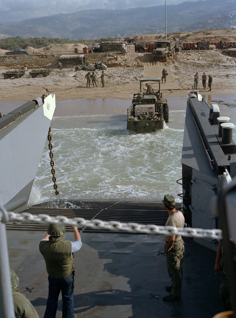 A utility landing craft unloads a rough terrain forklift at the beachfront encampment of the 24th Marine Amphibious Unit. The Marines have been deployed in Lebanon as part of a multi-national peacekeeping force following confrontation between Israeli forces and the Palestine Liberation Organization