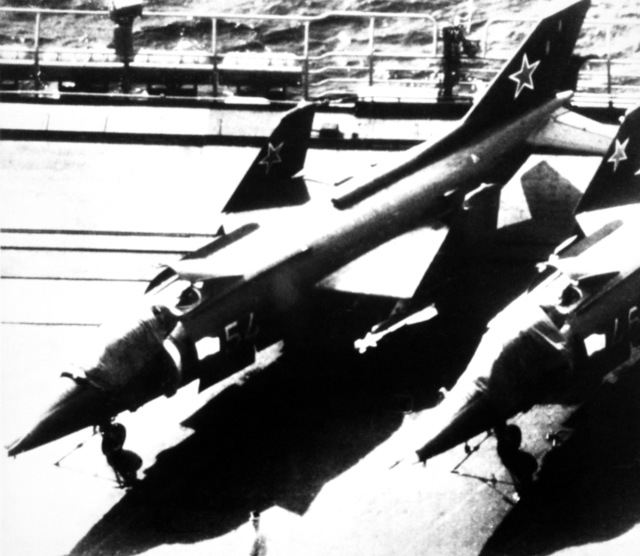 """A view of two Soviet Forger VTOL attack aircraft aboard the Soviet aircraft carrier Minsk (CVHG). """"Soviet Military Power,"""" 1983, Page 54 (SUBSTANDARD)"""