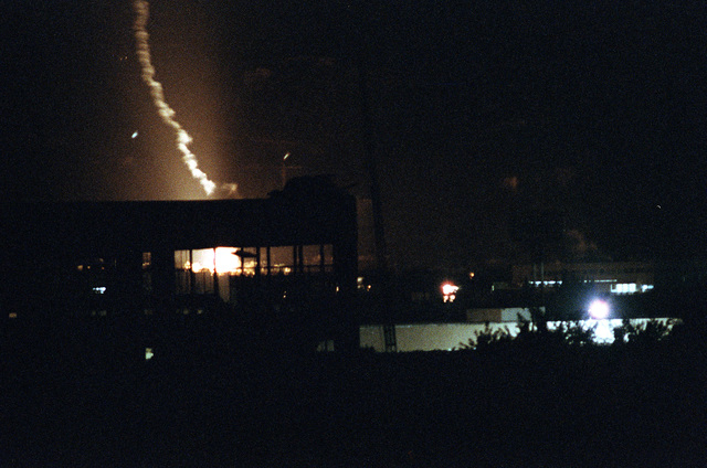 An explosion lights up the night sky over U.S. Marine headquarters at Beirut International Airport. The Marines have been deployed in Lebanon as part of the multi-national peacekeeping force following confrontation between Israeli forces and the Palestine Liberation Organization