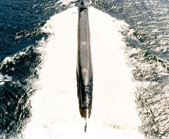 An overhead view of the nuclear-powered strategic missile submarine USS MICHIGAN (SSBN-727) underway
