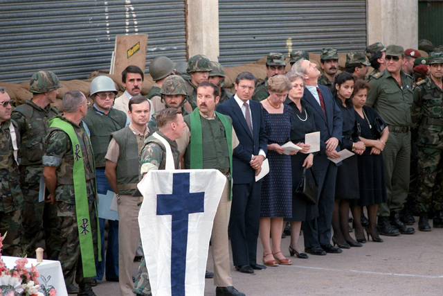 Chaplains, U.S. Marines and family members observe a moment of silence at memorial services for the 241 Marines killed during the terrorist bombing of the barracks at Beirut International Airport. The Marines have been deployed in Lebanon as part of the multi-national peacekeeping force following confrontation between Israeli forces and the Palestine Liberation Organization