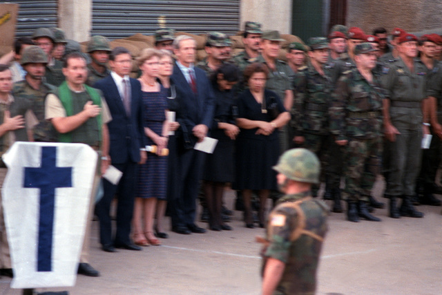 Chaplains, U.S. Marines and family members stand at attention during memorial services for the 241 Marines killed during the terrorist bombing of the barracks at Beirut International Airport. The Marines have been deployed in Lebanon as part of the multi-national peacekeeping force following confrontation between Israeli forces and the Palestine Liberation Organization
