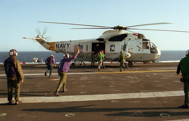Crewmembers board an SH-3A Sea King helicopter from Helicopter Anti-submarine Squadron 2 (HS-2) during a man overboard rescue drill aboard the aircraft carrier USS KITTY HAWK (CV 63). The squadron is assigned to the carrier