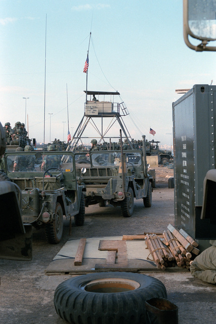 M151 light vehicles awaiting routine maintenance stand in the service area of a US Marine encampment. The Marines have been deployed in Lebanon as part of a multi-national peacekeeping force following confrontation between Israeli forces and the Palestine Liberation Organization