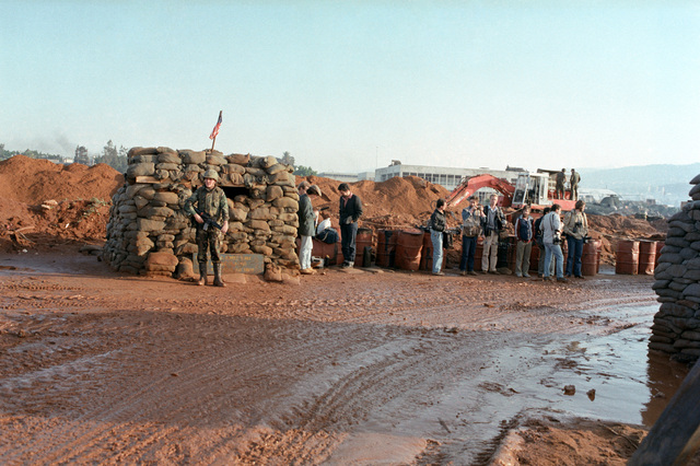 Members of the press visit a US Marine Corps encampment near the Marine barracks at Beirut International Airport. The Marines have been deployed in Lebanon as part of a multi-national peacekeeping force following confrontation between Israeli forces and the Palestine Liberation Organization