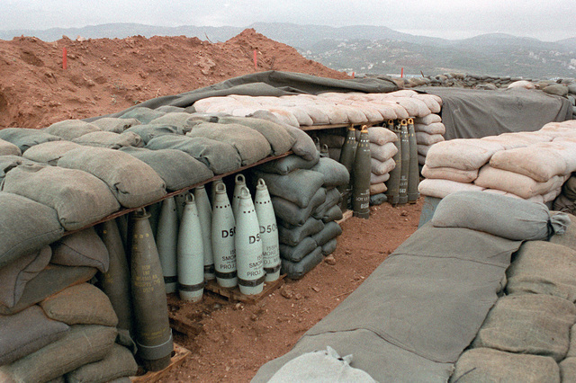 Sandbagged barricades conceal 155mm smoke projectiles in a U.S. Marine encampment. The Marines have been deployed in Lebanon as part of a multi-national peacekeeping force following confrontation between Israeli forces and the Palestine Liberation Organization