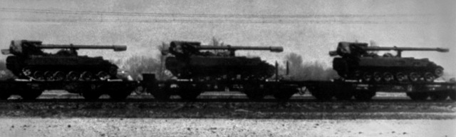 """Side view of three Soviet 152mm self-propelled guns being transported on railroad cars. """"Soviet Military Power,"""" 1983, Page 40"""
