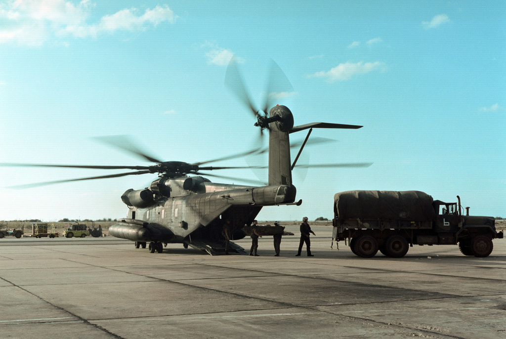 US Marines load mail from a truck into a CH-53E Super Stallion helicopter at Beirut International Airport. The Marines have been deployed in Lebanon as part of a multi-national peacekeeping force following confrontation between Israeli forces and the Palestine Liberation Organization