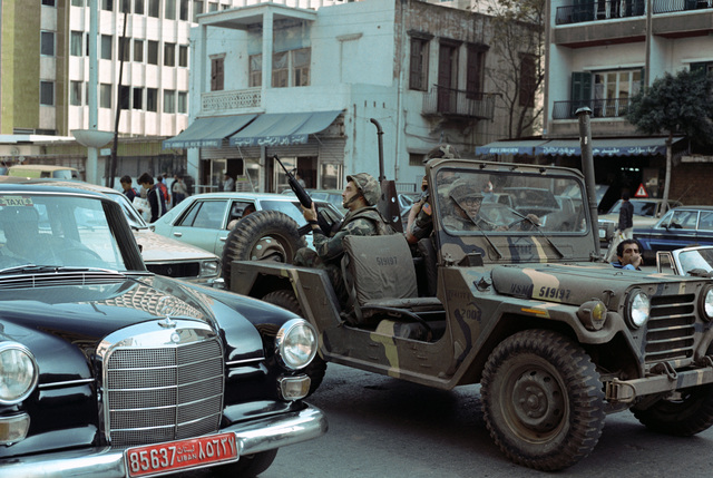 US Marines patrol the streets of downtown Beirut in an M151 light vehicle. The Marines have been deployed in Lebanon as part of a multi-national peacekeeping force following confrontation between Israeli forces and the Palestine Liberation Organization