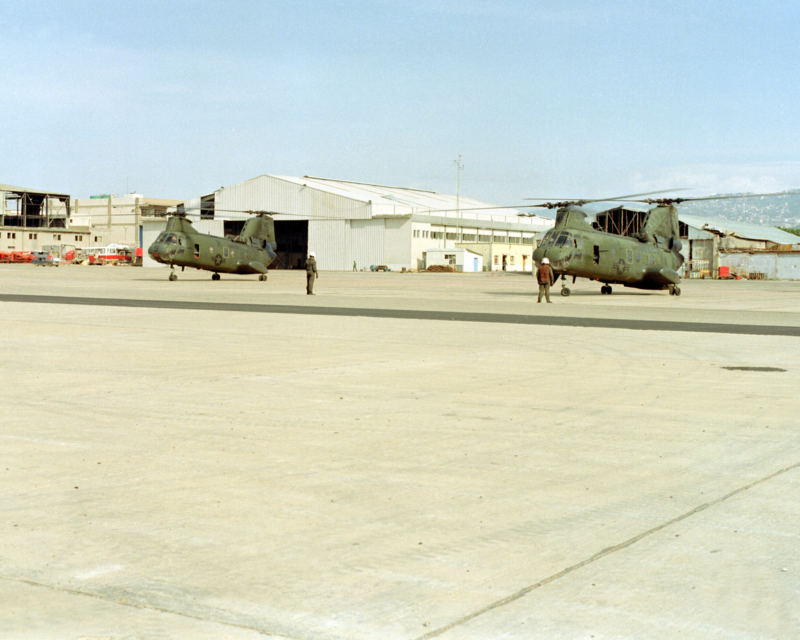 U.S. Marines prepare to load mail into CH-46 Sea Knight helicopters at Beirut International Airport. The Marines have been deployed in Lebanon as part of a multi-national peacekeeping force following confrontation between Israeli forces and the Palestine Liberation Organization