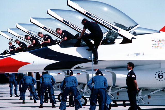A left side view, as pilots board, of six F-16 Fighting Falcon aircraft being used for the first time in an air show by the USAF Thunderbird Aerial Demonstration Team