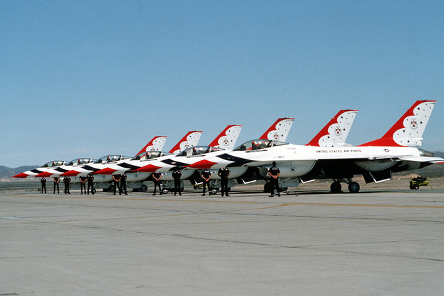 A left side view of six F-16 Fighting Falcon aircraft being used for the first time in an air show by the USAF Thunderbirds Aerial Demonstration Team