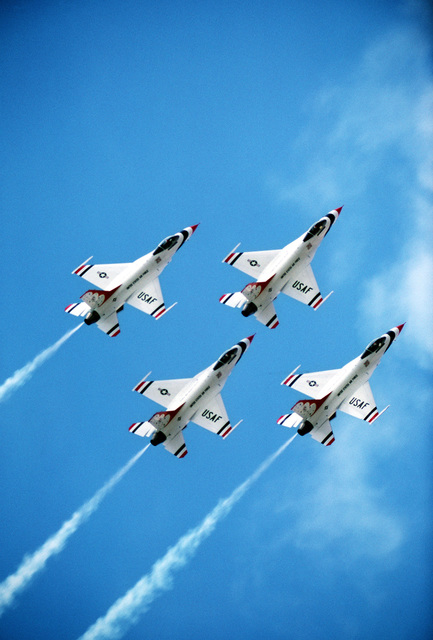 An air-to-air overhead view of four F-16 Fighting Falcon aircraft in a diamond formation during the aircraft's first public appearance as the USAF Thunderbird Aerial Demonstration Team's primary aircraft