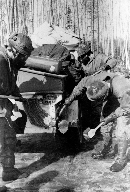 Members of the 1ST Battalion, 37th Field Artillery, scrub down a jeep trailer during NBC (Nuclear Biological Chemical warfare training