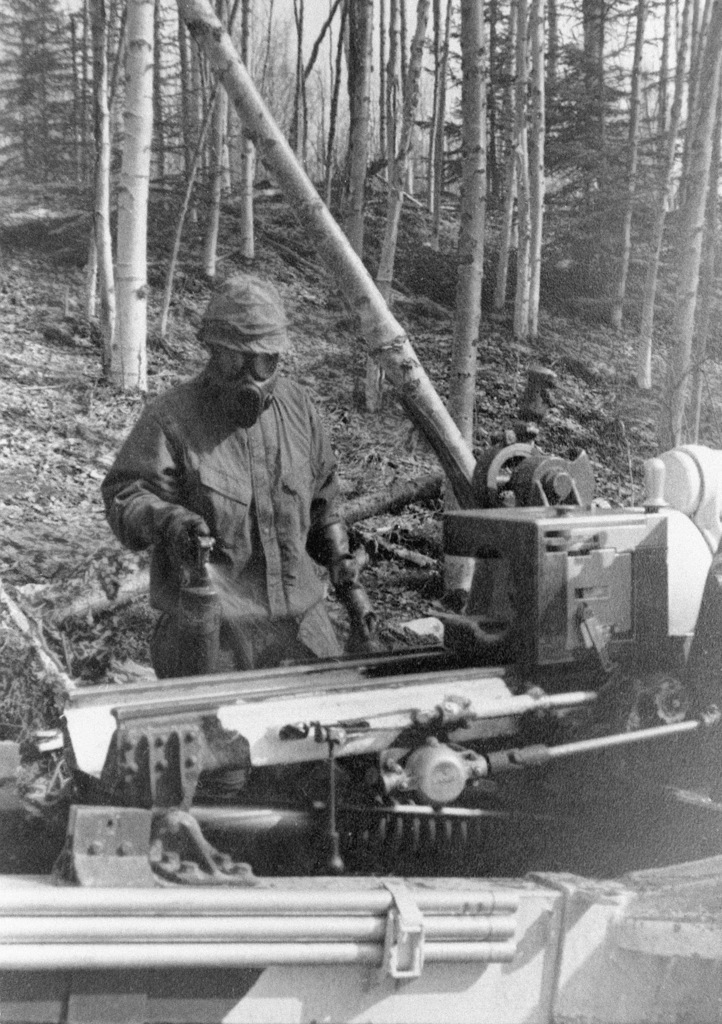 STAFF Sergeant Fred Moore of Battery C, 1ST Battalion, 37th Field Artillery, uses a spray to decontaminate artillery equipment during NBC (Nuclear Biological Chemical warfare training