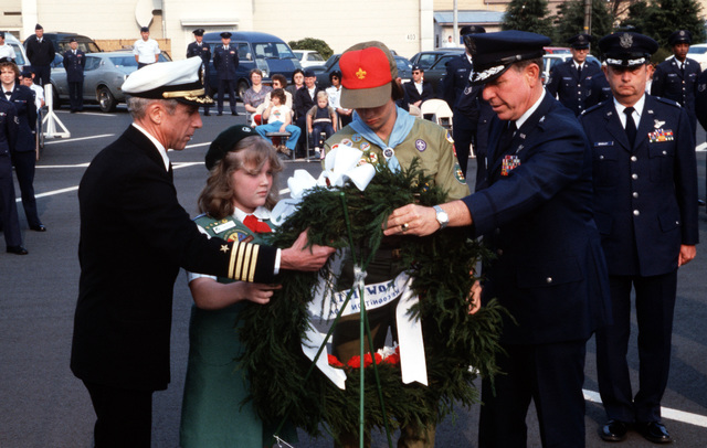 Captain Collins Hanes, a former prisoner of war, participates in a wreath laying ceremony honoring the missing-in-action in Southeast Asia. Also participating is Brigadier General Robert C. Bayer, Commander of the 5th Air Force
