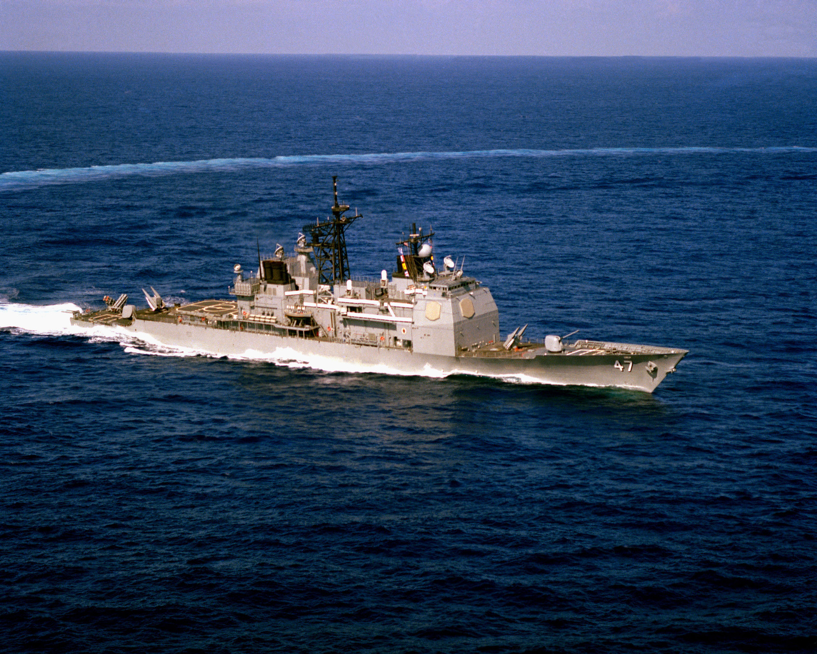 An aerial starboard bow view of the Aegis guided missile cruiser USS TICONDEROGA (CG 47) underway during Standard II missile tests near the Atlantic Fleet Weapon Training Facility, Roosevelt Roads, Puerto Rico