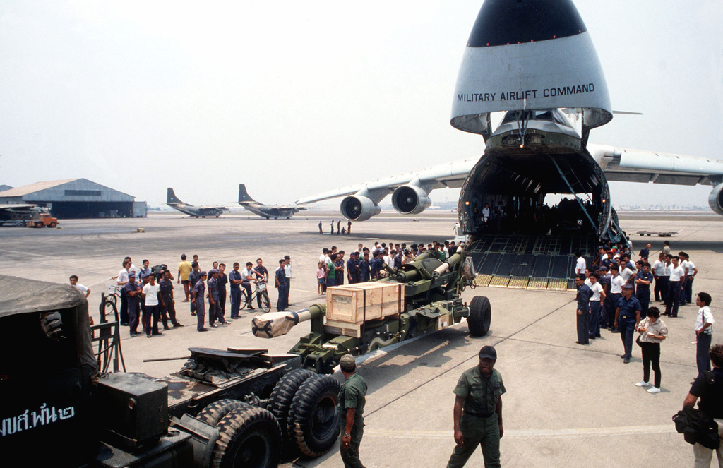 An M-198 155mm howitzer is off loaded from a C-5 Galaxy aircraft at Dong Muong International Airport. The C-5 delivered eight M-198's to the Thai military