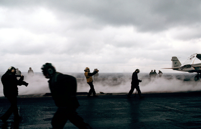 Steam rises from a catapult aboard the aircraft carrier USS MIDWAY (CV 41) during operations for the CINCPAC Exercise FLEETEX '83. The US Navy, Air Force, Coast Guard and the Canadian navy are participating in the exercise near the Aleutian Islands of Alaska