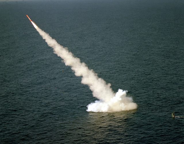 A Tomahawk (BGM-109) cruise missile is launched from the nuclear-powered attack submarine USS LA JOLLA (SSN-701). Its final destination is on the Tonapah Test Range in Nevada