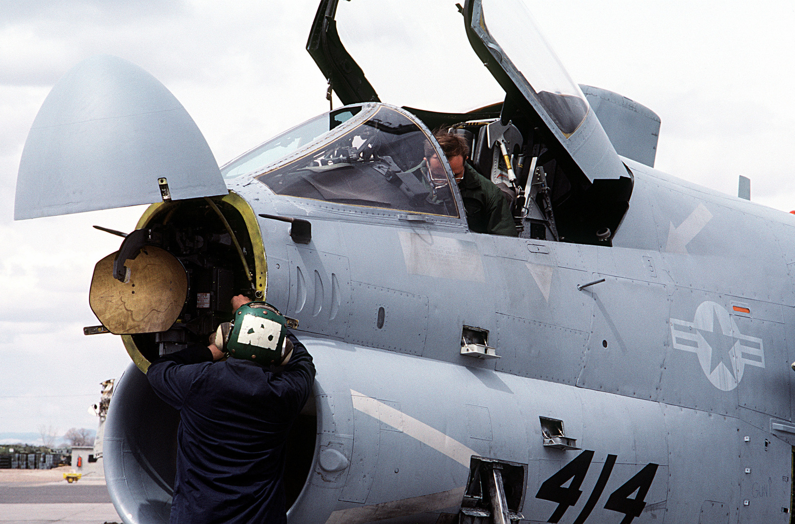 A ground crewman performs maintenance on the APQ-126 radar equipment located in the nose of an A-7 Corsair II aircraft from Carrier Air Wing 6 (CVW-6)