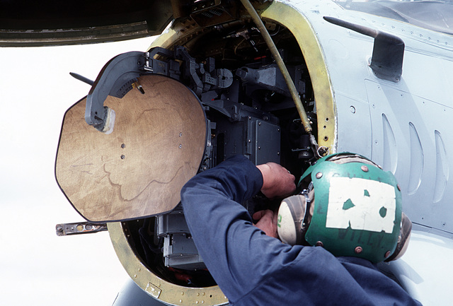 A ground crewmen performs maintenance on the APQ-126 radar equipment located in the nose of an A-7 Corsair II aircraft from Carrier Air Wing 6 (CVW-6)