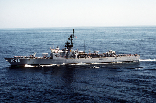 Aerial port beam view of the frigate USS SAMPLE (FF-1048) underway