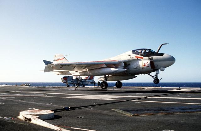 An A-6E Intruder aircraft lands on the flight deck during flight operations aboard the nuclear-powered aircraft carrier USS CARL VINSON (CVN 70)