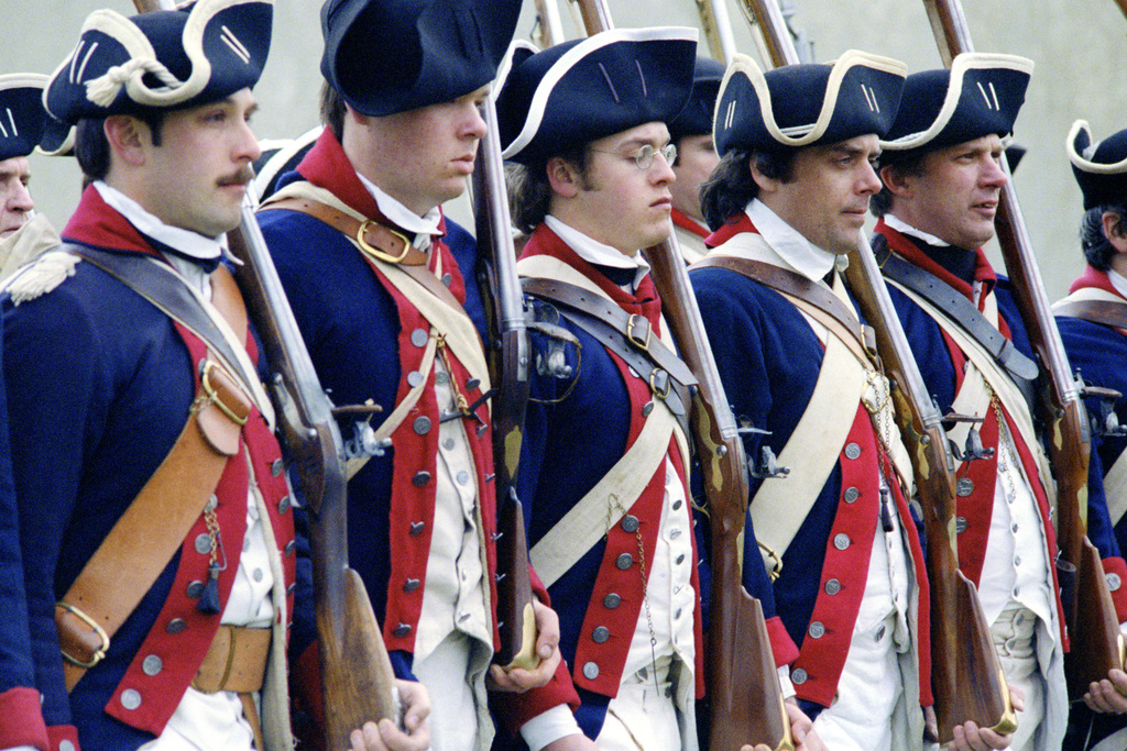 Troops wearing the Revolutionary War uniforms of the 9th
