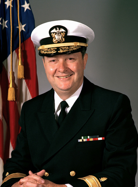 Commodore Edward J. O'Shea, USN (covered)