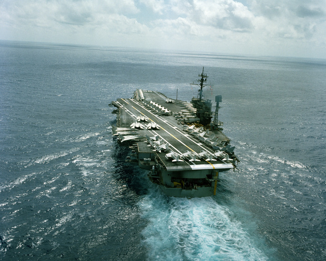 An aerial port quarter view of the aircraft carrier USS AMERICA (CV-66) underway