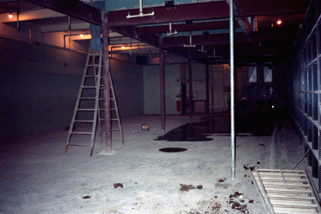 A workman is hardly visible atop his ladder, as work becomes nearly complete during destruction of the film storage vaults that must be demolished to make room for the Defense Audiovisual Agency, which is consolidating the audiovisual functions of the four services and moving them together under one roof
