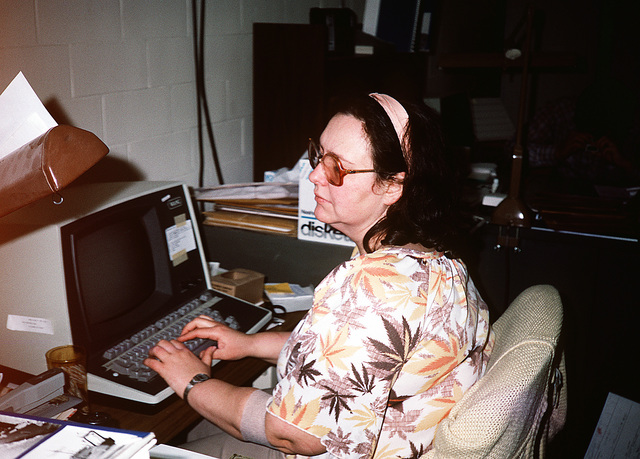 Janice McMahon, caption writer, operates the Wang word processor in the accessioning of new material for the Still Media files of the Audiovisual Agency, which is consolidating the audiovisual functions of the four services and moving them together under one roof
