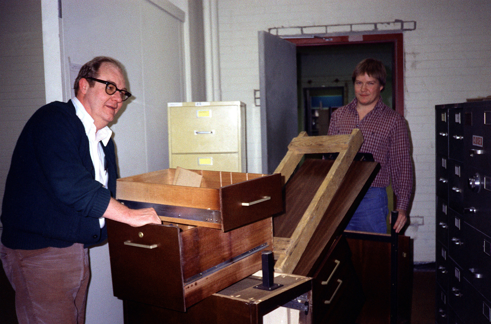 John Finn and Kevin Riordan lend a hand in moving the Army's collection as work progresses during the Defense Audiovisual Agency's consolidation of the audiovisual functions of the four services and moving them together under one roof