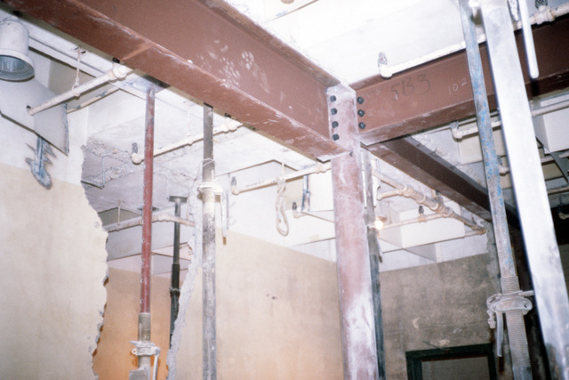 Strong bracing must be installed to avoid the collapse of the ceiling during destruction of the film storage vaults that must be demolished to make room for Defense Audiovisual Agency, which is consolidating the audiovisual functions of the four services and moving them together under one roof