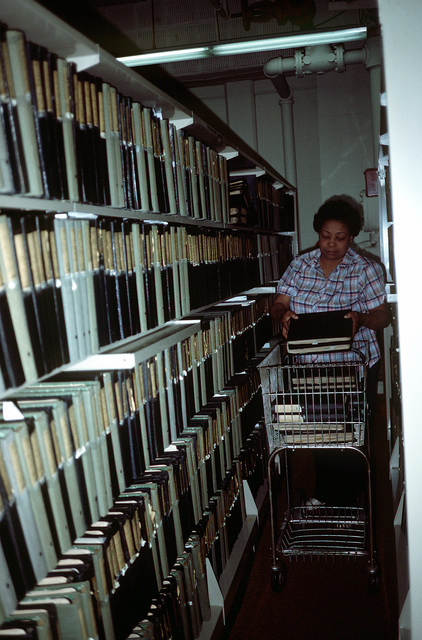 The Air Force pictorial file is temporarily established and manned here by Ms. Ada Scott, as work becomes nearly complete during destruction of the film storage vaults that must be demolished to make room for Defense Audiovisual Agency, which is consolidating the audiovisual functions of the four services and moving them together under one roof
