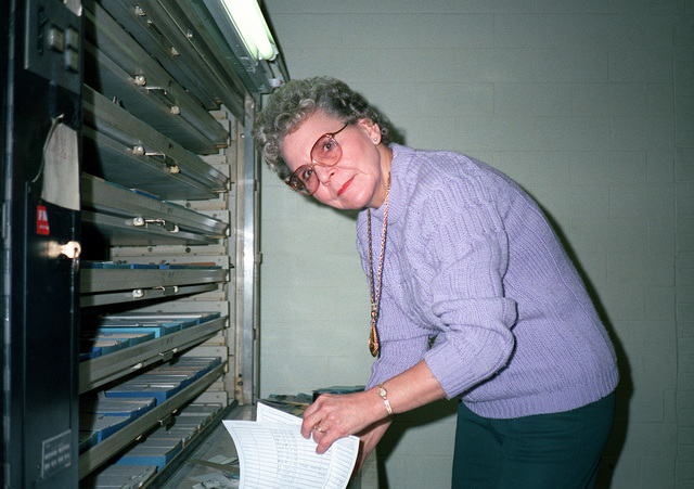 Virginia Horrell operates the Diebold machine as she does research for inquiries at the Defense Audiovisual Agency, which is consolidating the audiovisual functions of the four services and moving them together under one roof