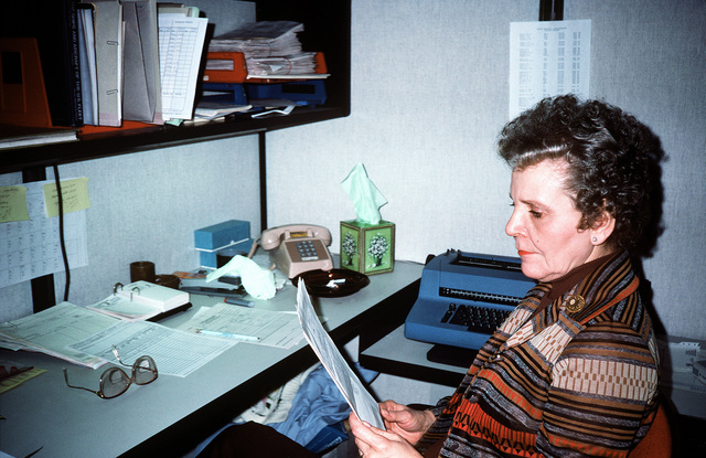 Virginia Horrell reads an incoming request in her job as a researcher at the Defense Audiovisual Agency, which is consolidating the audiovisual functions of the four services and moving them together under one roof