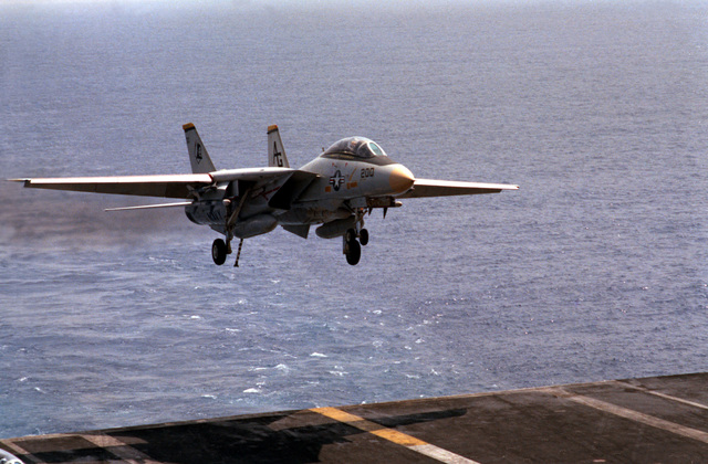 A Fighter Squadron 142 (VF-142) F-14A Tomcat aircraft comes in for a landing on the flight deck of the nuclear-powered aircraft carrier USS DWIGHT D. EISENHOWER (CVN 69). The plane is piloted by the Commander, Carrier Air Wing 7 (CVW-7), aboard the EISENHOWER
