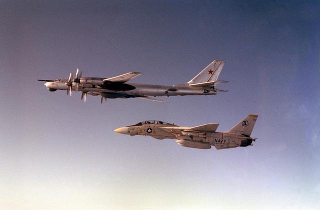 A Fighter Squadron 142 (VF-142) F-14A Tomcat aircraft from the nuclear-powered aircraft carrier USS DWIGHT D. EISENHOWER intercepts a Soviet Tu-142 Bear-D aircraft over the Mediterranean Sea