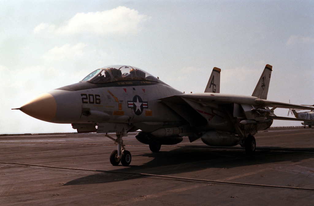 A Fighter Squadron 142 (VF-142) F-14A Tomcat aircraft taxis out of the landing zone after touching down on the flight deck of the nuclear-powered aircraft carrier USS DWIGHT D. EISENHOWER (CVN 69)