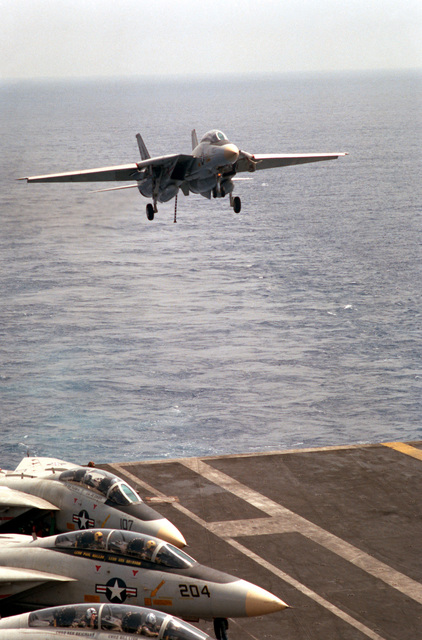 A Fighter Squadron 143 (VF-143) F-14A Tomcat aircraft comes in for a landing on the flight deck of the nuclear-powered aircraft carrier USS DWIGHT D. EISENHOWER (CVN 69)